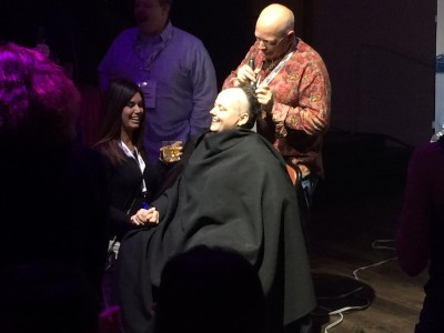 Kellie Peterson gets shave by Greg Tripleg at the Water Night Party